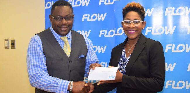 Flow's Barbados Director of Corporate Communications & Stakeholder Management, Marilyn Sealy  presenting the sponsorship cheque to Minister of Social Care, Constituency Empowerment and Community Development Steve Blackett.