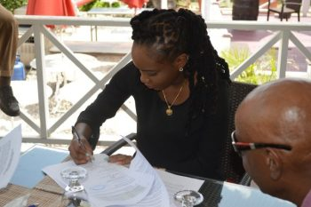 Aziza signing her contract earlier today.