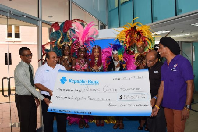 From Left: Republic Bank's Manager of Customer Services Bryan Charles, General Manager, Corporate and Commercial, Sean Husain; Band Representatives from Aura Experience, Fifth Element and Jump Promotions, Cranston Browne CEO of NCF [in Black] and Adisa 'Aja' Andwele accepting the cheque presented by Republic Bank.