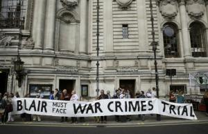Demonstrators protest before the release of the John Chilcot report into the Iraq war, at the Queen Elizabeth II Centre in London, on Wednesday.