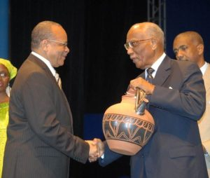 Dr Jean Holder (left) receiving a Lifetime Award from Governor General  at the time Sir Clifford Husbands for his role as one of the founders  of NIFCA, in 2008. (Picture courtesy Dr Holder)