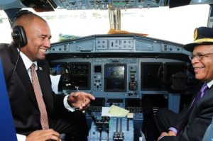 Dr Holder (right) and Minister of Tourism Richard Sealy in the cockpit of a new addition to the LIAT fleet in June 2013.