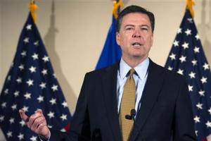 FBI Director James Comey makes a statement at FBI Headquarters in Washington, Tuesday.