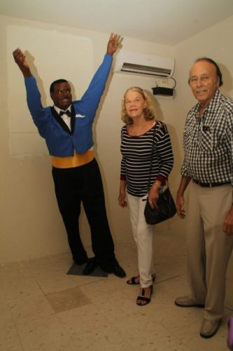 Here musician Emile Straker and his wife pose next to the wax sculpture of Barbados' Father of Independence Errol Walton Barrow.