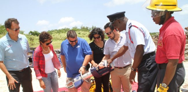From left, Glen Thompson of IRP Fire and Safety in Trinidad; Dr Anne Kissoon-Corbin; Regional Manager of Hurst Jaws of Life Paul Felegy; Comarie Mansour; Immediate Past President of the Rotary Club of Barbados West Farid Mansour; Deputy Training Officer and Sub Officer Acting Ryan Austin and Acting Leading Fire Officer Wayne Vaughan with the new Jaws of Life cutter.