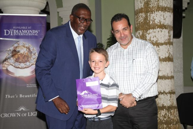 Top Boy Zachary Gill of St. Gabriel's accepting his gift from Senator Harcourt Husbands (left) and Managing Director of Diamonds International Jacob Hassid.