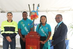 From left, General Manager of Arawak Cement Co Ltd Manuel Toro, St Lucy Parish Ambassadors Rario Rock and Melissa Sobers and St Lucy MP Denis Kellman were included in the welcoming party for the ceremonial Broken Trident.