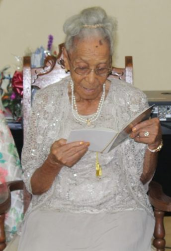 Emeline Stoute reading one of her birthday cards.
