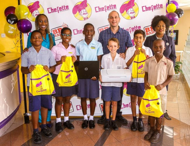 From left, Tre Thorington; Marquest Clarke-Griffith, Chefette marketing officer; Tori Mayers; Adia Deane; Zachary Gill; Ryan Haloute, Chefette managing director; Gabriel Muhajiri; Jahfere Wilson; Lisa Carter, Chefette advertising manager.
