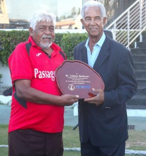 Lalman Kowlessar coach of Presentation College out of Trinidad and Tobago (left) has made an invaluable contribution to the Sir Garfield Sobers Cricket Tournament and was given a special award by the man himself.
