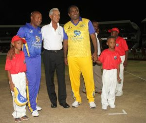 Man of the moment Sir Garry Sobers (center) is flanked by Brian Lara (second left) and Carl Hooper (second right) as they soak in the adulation of the massive crowd.
