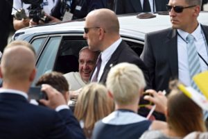 Pope Francis (centre) greets the faithful as he leaves a welcome ceremony at the Balice Airport in Krakow, Poland on Wednesday.