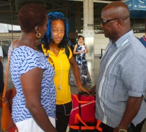 President of the Athletic Association of Barbados Catherine Jordan (left) in conversation with Sada Williams and former Olympian Noel Lynch.