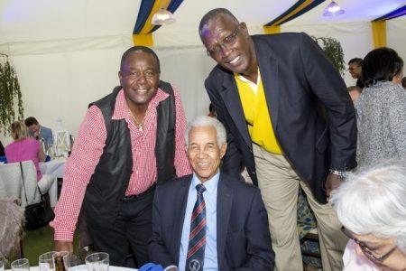 Here Desmond Haynes poses with national hero Sir Garry Sobers and fellow cricket legend Joel Garner.