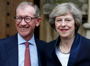Theresa May emerges with her husband Philip to speak to reporters after being confirmed as the leader of the Conservative Party and Britain's next Prime Minister outside the Houses of Parliament in Westminster, central London, on Monday.