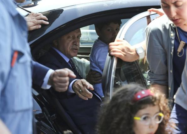 Turkish President Tayyip Erdogan sits inside a car with family members at Istanbul airport, Turkey, July 16, 2016. REUTERS/Huseyin Aldemir