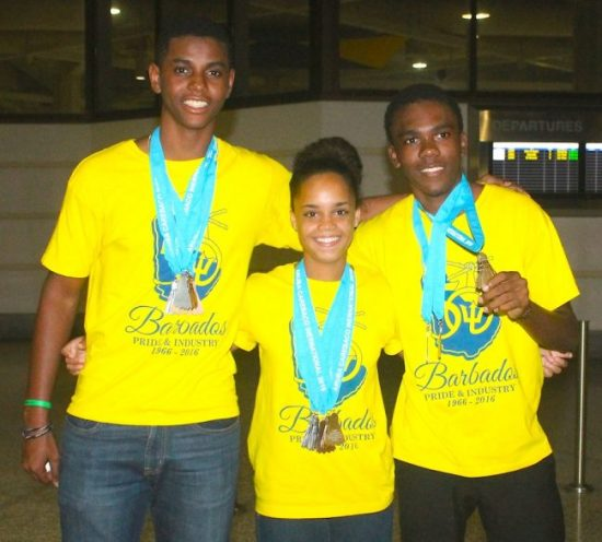 Barbados did exceptionally well at CAREBACO thanks to Shae Martin (left) Amanda Haywood (center) and Keshem Moore who won gold in the mixed double and male double respectively. (Pictures by Morissa Lindsay)