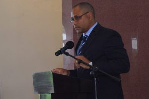 George Nicholson Jr, son of Professor George Nicholson delivers the eulogy at Wednesday's funeral service.
