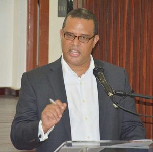 Jamaican High Commissioner, David Prendergast, addressing nationals resident in Barbados.