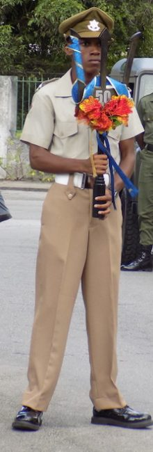 Deon Butcher of the Cadet Corps holding the Commemorative Broken Trident.