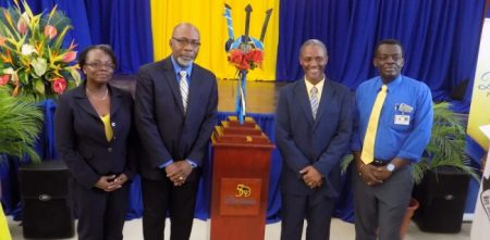 From left: Finance Officer of the Barbados Community College Judith Newsam, BCC Principal Dr Ian Austin, Deputy Principal Samuel Rousse and Acting Registrar Roger Worrell alongside the Commemorative Broken Trident.