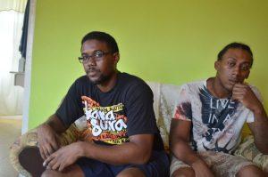 Jamar Scott's fraternal twin brother Jamel Scott (left) and older sibling Damien.