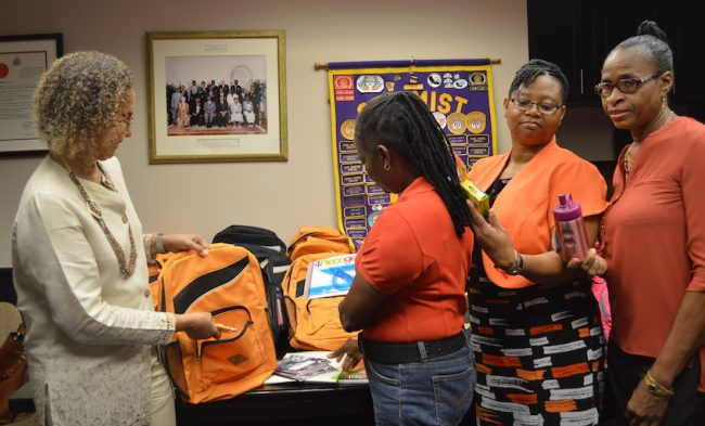 President of the Optimist Club of Bridgetown Lady Carol Haynes (left) and principals Jennifer Hoyte of Arthur Smith Primary (second from left), Pamela Ifill of Belmont Primary (second from right) and Marline Abrams of Grantley Prescod Primary (right) looking at the stationery.