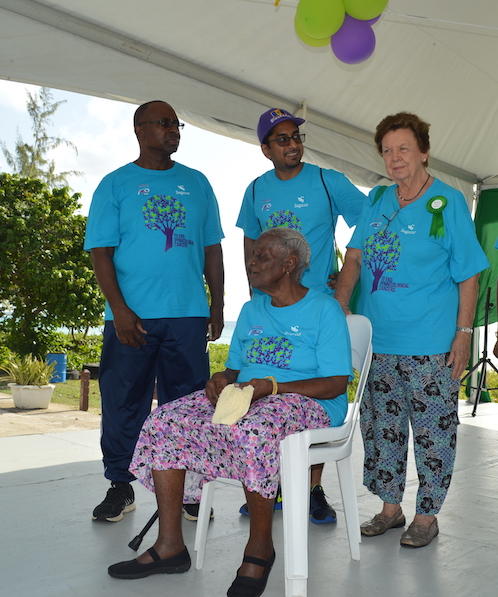 From left: Senior Consultant in the Obstetrics & Gynaecology Department at the QEH, Dr Wayne Welch, Clinical Director of the Barbados Cancer Society,  Dr Vikash Chatrani, the oldest surviving cancer patient in Barbados, 99-year-old Rosalie Bailey (sitting), and President of the Barbados Cancer Society  Dr Dorothy Cooke-Johnson after cutting the ribbon to get proceedings started.