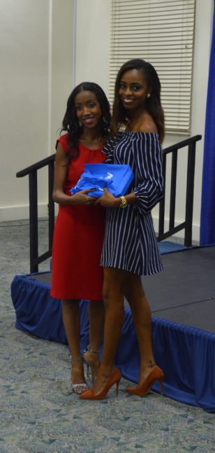The lady with the fiercest walk, Ukweli Wilson, receiving her prize from Natasha Morgan.