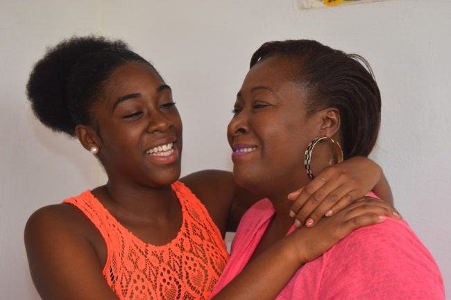 High achiever Cherece Richards (left) being embraced by her mother Anita Fenty as they celebrate her CXC results.