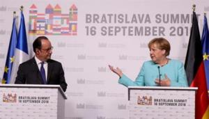 French President Francois Hollande (left) and German Chancellor Angela Merkel, attend a press conference after the EU summit in Bratislava Friday.