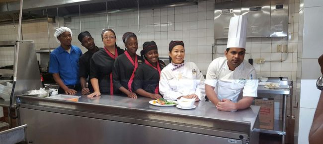 Executive chef Abunasar Siddiqui (right) and new Thai chef Mayuree Saipetch (second right) with part of the kitchen staff in the Pacifika restaurant.