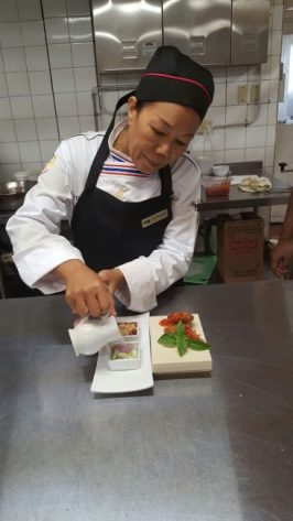 New Thai chef Mayuree Saipetch preparing an appetizer for the special guests.