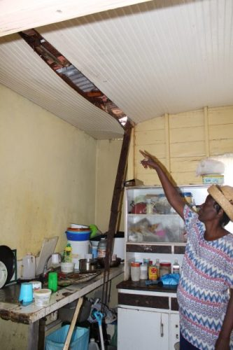 Moncrieffe resident Mardel Vaughn pointing out damage to her ceiling.