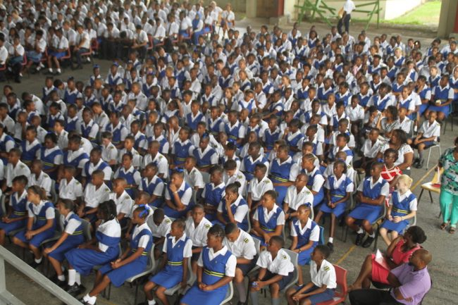 St Michael School students listening attentively as they began the new school term this morning.