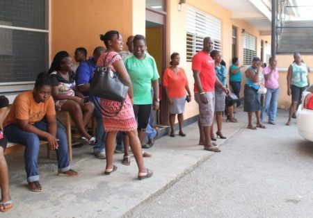 Some parents at the Deacons Primary School this morning as their wards begin the new school term.