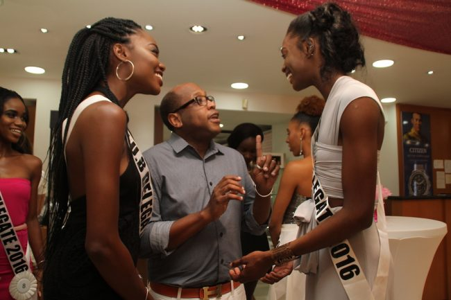 Two of the contestants speaking to national director of the Miss Universe franchise  Brian Greene.