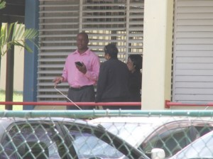 Principal Clova Alleyne (partially hidden) and a ministry official in conversation with BUT President Pedro Shepherd (left).