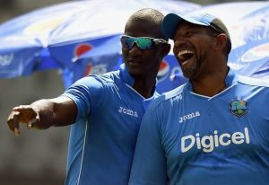 Phil Simmons (right) in happier times with former Twenty20 captain Darren Sammy.
