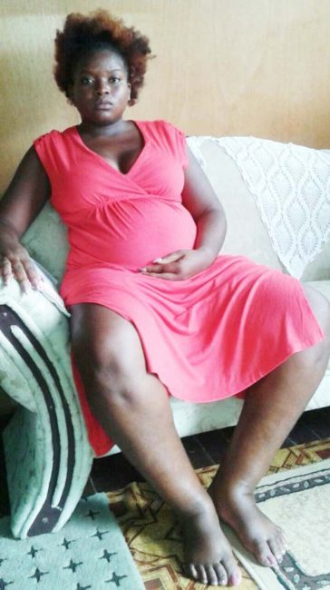 Pregnant Annecia Alfred at home yesterday, showing her feet that became swollen from sitting in one position for hours.