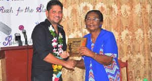 Ramnaresh Sarwan is presented with a plaque by head-mistress of the Stella Marris Primary School, Natalie Author. (Picture compliments Guyana Chronicle)