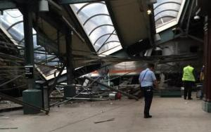 This photo provided by a passenger who was on the train when it crashed shows wreckage at the Hoboken, New Jersey rail station.