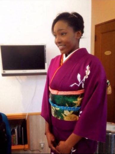 In traditional Japanese dress for a graduation.