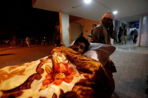 A police cadet injured during the attack on the Police Training Centre is wheeled into a hospital in Quetta, Pakistan.