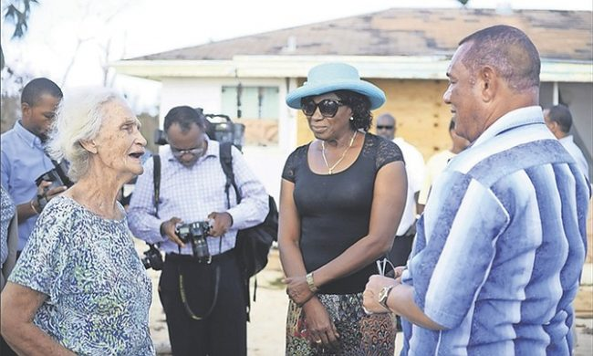 A resident of Adelaide talks with Prime Minister Perry Christie (right) and Urban Renewal Co-Chair Cynthia 'Mother' Pratt (second right) during a walkabout yesterday to view damage caused by Hurricane Matthew.