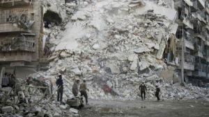 Aftermath of air strike on Qaterji in rebel-held east Aleppo.