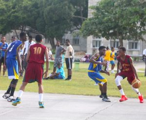 Brandon Ruck of Graydon Sealy (with ball) top-scored with ten points for his school. Here he looks to dribble past Combermere's top-scorer Theo Greenidge. (Picture by Morissa Lindsay)
