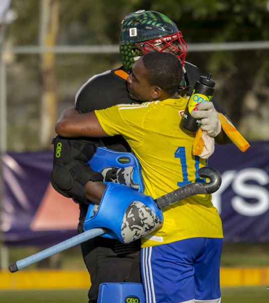 Captain Andre Boyce (GK) and vice captain Laurando Davis celebrate Saturday's hard fought victory over hosts Mexico.