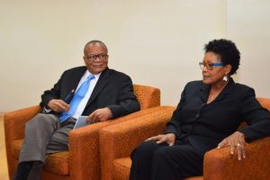 LIAT Chairman Jean Holder in discussion with the carrier's Acting CEO Julie Reifer-Jones, who is  said to be among the 51 applicants for the top post.