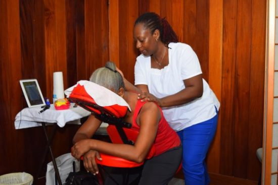 Massage therapist Dawn Boxill provides some relief to a Ministry of Education staffer.